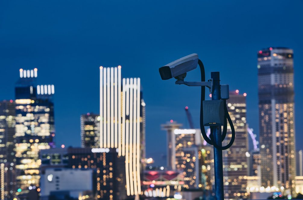 Security camera against urban skyline